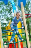 Girl having fun in playground Stock Photo