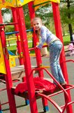 Girl having fun in playground Stock Images
