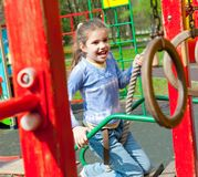 Girl having fun in playground Stock Photography
