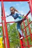 Girl having fun in playground Stock Photos