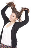 Girl having fun and pulling her long hair Royalty Free Stock Photos