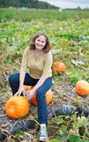 Girl having fun on the pumpkin patch Royalty Free Stock Photography