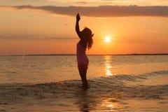 Girl having fun on the sea beach Stock Photos
