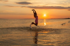 Girl having fun on the sea beach Royalty Free Stock Photography