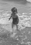 Girl having fun in the sea. Black and white portrait of a little girl having fun in the sea Stock Image