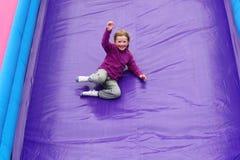 Girl Having Fun on Slide Royalty Free Stock Images