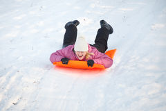 Girl having fun in snow Royalty Free Stock Images