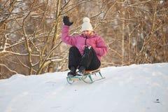Girl having fun in snow Stock Photo