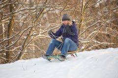 Girl having fun in snow Stock Photos