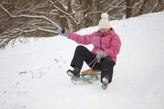 Girl having fun in snow Stock Images