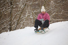 Girl having fun in snow Stock Images