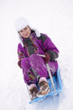 Girl having fun in snow Stock Photo