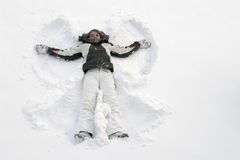 Girl having fun in the snow Stock Image