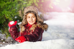 Girl having fun with snowball fight winter outdoor Royalty Free Stock Photography