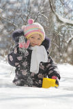 Girl having fun in snowy park Royalty Free Stock Photos