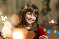 Girl Having Fun with Sparkler Stock Photo