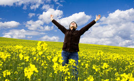 Girl having fun in summer rape field Stock Photo