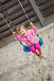 Girl having fun on a swing Stock Photos