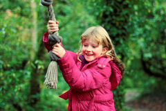 Girl Having Fun on Tree Rope Swing Stock Images