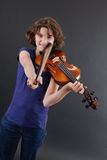 Girl having fun with a violin Stock Image