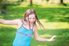 Girl having fun outdoor with water Royalty Free Stock Photography