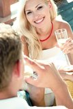 Girl having fun - white wine on a date Royalty Free Stock Image