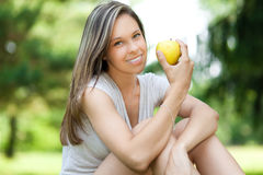 Girl having a healthy apple snack Stock Image