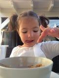 Girl having a healthy breakfast outdoors Royalty Free Stock Photos