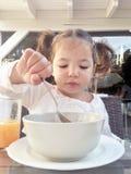 Girl having a healthy breakfast outdoors Stock Photo
