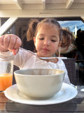 Girl having a healthy breakfast outdoors Stock Photography