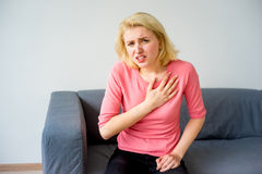 Girl having a heartache. A portrait of a girl suffering from a heartache Stock Photography