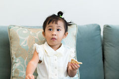 Girl having her snack Stock Images