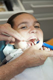Girl having her teeth checked by doctor Royalty Free Stock Images