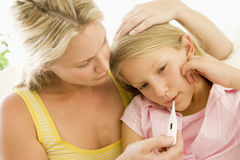 Girl Having Her Temperature Measured Stock Photography