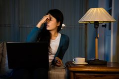 Girl having high intraocular pressure at night. Beautiful business girl having high intraocular pressure at night while working in free clothing at comfortable Stock Image