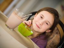 Girl having a snack Stock Photo