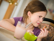 Girl having a snack Royalty Free Stock Photos
