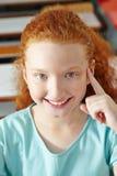 Girl having idea in school class royalty free stock photo