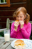 Girl is having lunch Stock Photo