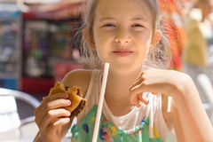 Girl having the lunch at a fast-food restaurant Stock Photo