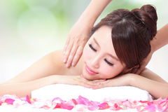 Girl having a massage for shoulder Royalty Free Stock Photo