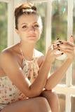 Girl having morning cup of coffee or tea Stock Photo