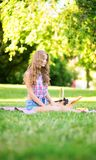 Girl having a picnic in park Stock Images