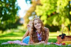 Girl having a picnic in park Stock Image