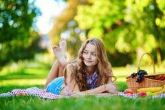 Girl having a picnic in park Stock Photos