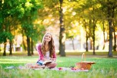 Girl having a picnic Royalty Free Stock Photos