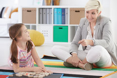 Girl having private lesson. School girl having private lesson with nice teacher Stock Photos