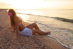 Girl having relaxing on sea beach Royalty Free Stock Images