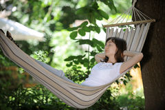 Girl having rest in a hammock Royalty Free Stock Image