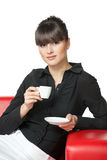 Girl having rest on the sofa with cup of coffee Royalty Free Stock Photo